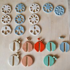 Glazed A Alicia ceramic pieces waiting to be turned into finished jewellery / decorations