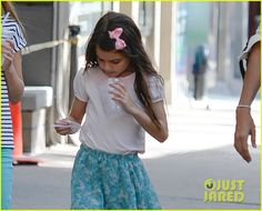 Katie Holmes takes her daughter Suri out on July 14, 2013