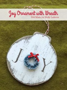 Celebrate Christmas with Handmade ornaments like this wood Joy ornament accented with a miniature wreath.