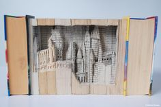 DESIGN PORTFOLIO BY HELEN DAVIES, 18.- Hogwarts Book Sculpture. I used 7 books (already damaged) to create the sculpture and 50 different scalpol blades. It took 3 months to create!