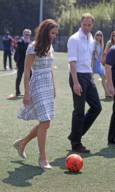 No sneakers? No problem! The stylish royal proved she could just as easy kick around a soccer ball in wedges, while visiting Bacon's College in 2012.