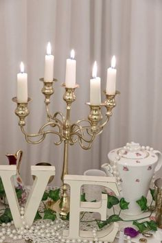 All Decor and Styling provided by Crow Hill Weddings. Fresh Flowers provided by Roxanne at Lily Blossom. Fresh Flowers, Crow, Lily, Chandelier, Ceiling Lights, Candles, Pearls, Weddings, Elegant