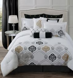 Classy Bed Sheet and Comforter Set with Black Euro Sham Cover with Gold Geometric Pattern and White Flanged Standard Sham Cover. Three Decorative Accent Pillows with White Comforter with Black Gold Damask Embroidery Set and Dark Grey Tailored Bedskirt, along with Mirrored Nightstand, Black Window Curtain