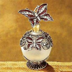 StealStreet SS-A-51617 Butterfly Crystal Jewel Fragrance Perfume Bottle StealStreet http://www.amazon.com/dp/B002WPMR9I/ref=cm_sw_r_pi_dp_trVTub1X7AEN8