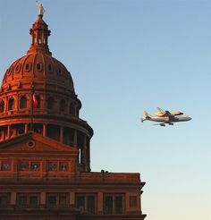 Space shuttle Endeavour, atop the shuttle aircraft carrier, flies past the Texas State Capitol in downtown Austin early Thursday, Sept. 20, 2012.  (Photo: Marco Hanson / AP)