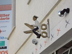This is a unique artistic shop sign for a hair cutter shop called 'Riedi's Hairport'. It is located at the streeet called 'Obere Gerberstraße' in Reutlingen, Germany, Baden-Württenberg.
