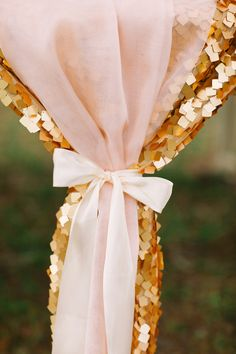 Pink tulle runner on gold sequined linen with a bow. Styling: Emily Grace Design.