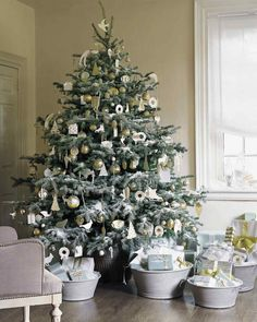 White Christmas: Christmas Morning | Martha Stewart Living — A Christmas tree dusted with snow looks even frostier when decorated exclusively in shades of silver, white, and cream.