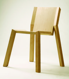 designed to meat the term - cut. The chair was created entirely from a single plywood plate, then formed into a chair structure by angular joints and cuts.