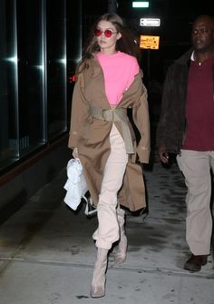 Gigi Hadid Photos Photos - Model Gigi Hadid was seen making an interesting fashion statement in a long brown coat and some eye-enhancing red glasses while out in New York City, New York on February 10, 2017. - Gigi Hadid Looks Fashionable In NYC