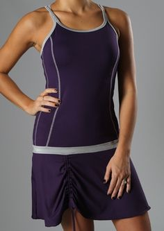 """Semi-fitted  Dual spaghetti straps  Contrast top stitching  Contrast band at hips  Adjustable ruching on skirt  Internal 360 bra w/removable padded support  """"StayDry"""" Wicking Microfiber Material  UV Protection UPF 50 - Blocks 98% of sun's UV rays  Anti-Bacterial Treatment  Dress length: 24 ½""""          $90.00      Product Code: 201120"""
