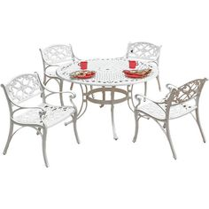 Poolside or on the patio, this classic openwork dining set is ideal for enjoying alfresco cocktails with family and friends.  Produc...