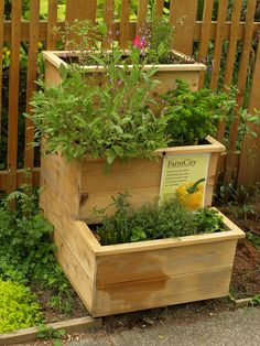 Tiered Herb Garden...wonder if I could bribe my husband into building me one...