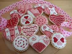 Valentine heart cookies - My Valentine cookies. Buttercookies covered with Royal icing and some of them have fondant details. I LOVE pipping cookies, I am addict... I can't stop until I have no more royal icing on my bag!!!