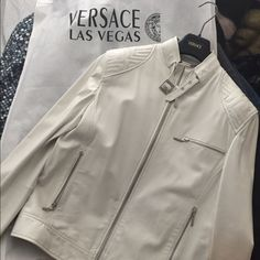 Versace Lamb skin white leather jacket I bought this last year at Las Vegas the forum shop Versace store. I only worn it couple times. It is in mint condition and this is a very rare color and quality is excellent. You cannot find another one on the market. Versace Jackets & Coats