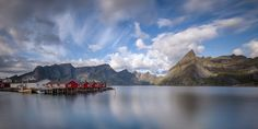 Calm Seas in Lofoten - A long exposure shot of the Reinefjord surrounded by majestic mountains and cosy small red cabins. Lofoten, Long Exposure, Cosy, Mountains, Landscape, Amazing Nature, Seas, Cabins, Travel