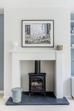 Chesney's contemporary gas stove, slate hearth, Lowry print. Log Burner Living Room, Living Room With Fireplace, New Living Room, Interior Design Living Room, Living Room Designs, Living Room Decor, Kitchen Interior, Dining Room, Wood Burner Fireplace