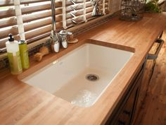 An extra-large, single-basin undercounter sink, chosen by online voters, lends farmhouse style to the rustic-chic kitchen. Cherry butcher block countertops
