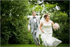 bride and groom running from a storm