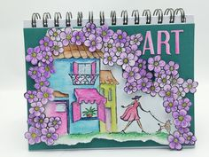Lori Williams designing for @CraftersCompUS Journal Cover , Spectrum Noir Watercolor pencils : Aegean Blue, Bottle Green, Petunia, Deep blue, Sky Blue, Sorrel, Pesto, honeycomb, Soft Red, Hyacinth Sheena A little bit scenic: French 50's Café,