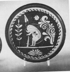 Apulian red figure dish with acrobat. Charles Ede Ltd, Greek Pottery from South Italy VI (1978) no. 7. Diam 21.9cm. Check RVAp ii, workshop of the Darius Ptr.                                Special thanks to Prof. J.R.Green