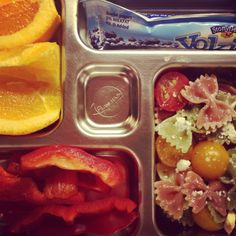 Planet box, planetbox, healthy kids' lunches, school lunch  Organic vegetable bowtie pasta mixed with local grape/sun tomatoes, crumbled feta cheese and Newman's Own dressing; sliced navel oranges, local red bell pepper slices, Yo Kids organic blueberry yogurt tube