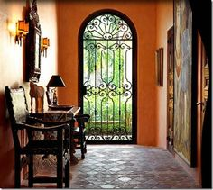 Foyer with black iron gate Spanish style House like this on coffeepot blvd I love! Spanish Style Decor, Spanish Design, Spanish Style Homes, Spanish House, Spanish Tile, Style Hacienda, Mexican Hacienda, Mexican Style, Hacienda Decor