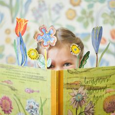 smiling girl with book and flowers