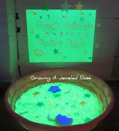 Planets, Asteroids, and shooting stars sensory play.  Glowing water beads to explore space objects.