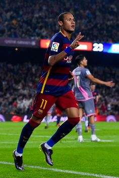 Neymar of FC Barcelona celebrates after scoring his team's third goal during the La Liga match between FC Barcelona and Rayo Vallecano at the Camp Nou stadium on October 17, 2015 in Barcelona, Catalonia.