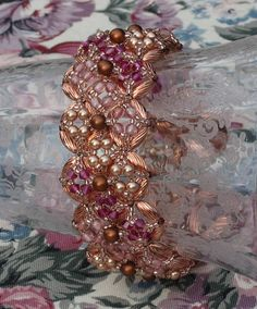 Bracelet - Swarovski Crystals and Pearl in Copper and Pink.  Embellished Right Angle Weave http://www.jayceepatterns.com/fancypatternspg.html