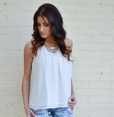 """Deck yourself in this Pleated Chiffon Tank for the evening. While enjoying a casual night out or attending a fabulous party, this sheer top will create a fun, yet demure, look. Dress up your ensemble with a glittery clutch, sequined skirt, and bejeweled blazer or play it down with high-waisted jeans and sleek, black booties and say """"Hello!"""" to a variety of vivacious new styles!"""