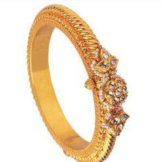 Gold kada with pearls and kundan