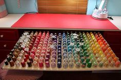 Awesome thread storage idea! Notice how even this is NOT enough? Several spools upside down because it would not all fit!