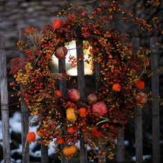 beautiful fall wreath of rosehips and berries