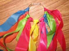 Rainbow Rings -Great music and movement idea. Open ended as children can use it to form patterns of ribbon, can be used for dramatic play, but also for music and dance.