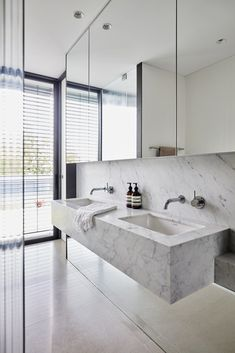Tagged: Bath Room, Marble Counter, Undermount Sink, and Marble Wall. Photo 13 of 13 in A Sleek, Two-Story Addition Hides Behind a Traditional Cottage in Sydney