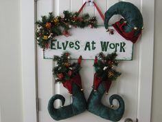 Handmade Christmas Decoration Door Hanger Elf Hat and Boots. Elves At Work. $30.00, via Etsy.