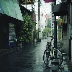 rainy street. by Momota.M, via Flickr