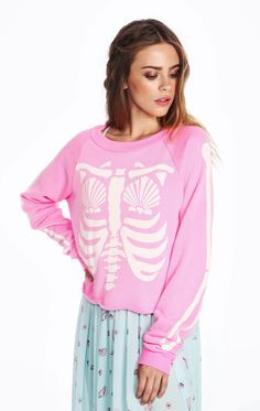 We're 100 percent mermaid, inside and out. Oversized and cropped, sherpa fleece pullover in a vintage inspired. Crewneck. Long sleeves with banded hems.  In Party Girl Pink. 70% Cotton, 30% Polyester Model wears a size small
