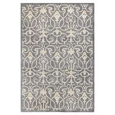 """Anchor your dining set or living room seating group with this hand-tufted wool rug, showcasing a damask-inspired motif in grey. Product: RugConstruction Material: WoolColor: GreyFeatures: Hand-tufted Pile Height: 0.5""""Note: Please be aware that actual colors may vary from those shown on your screen. Accent rugs may also not show the entire pattern that the corresponding area rugs have.Cleaning and Care: Regular vacuuming and spot cleaning recommended. Rug pad required."""