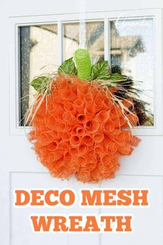 Get ready for fall with this simple, fun deco mesh pumpkin wreath! #wreath #fallwreath #halloweenwreath #halloweencrafts #fallcrafts #decomesh #decomeshwreath #falldecor #craftsbyamanda