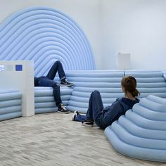 A room where teenagers can hang out designed byMathieu Lehanneur has opened at the Centre Pompidou in Paris. Called Studio 13/16, the interior features a twisting lighting and electrical track suspended from the ceiling, which can be used for filming, installing displays and suspending screens. Blue ribbed seating forms a landscape to relax on, punctuated