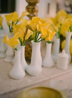 Milk glass with all yellow flowers - perfect spring and summer centerpiece inspiration!