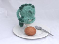 I really don't understand the purpose of an egg cozy but this sure is cute! dragon egg cozy dragon egg cosy by colouritgreen on Etsy, £11.00