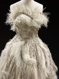 Balmain | c. 1950    Sequins, feathers and rhinestones.