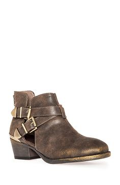 Ankle boots featuring a dusted gold hue, cutouts on ankle, two adjustable buckle straps, back zipper closure, and a metal plate above heel.