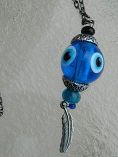 Handmade Round Blue Glass Evil Eye Pendant by bySUNSHINELAND