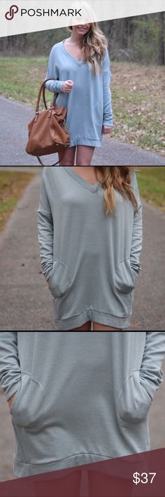 Soft knit tunic This soft knit sweater tunic features a V-neckline, long sleeves, and front pockets.   -wearing size small Dresses Mini