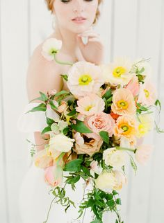 A colorful mix of poppies gave way to lush roses and baby peonies in this cascading Bows and Arrows spray.